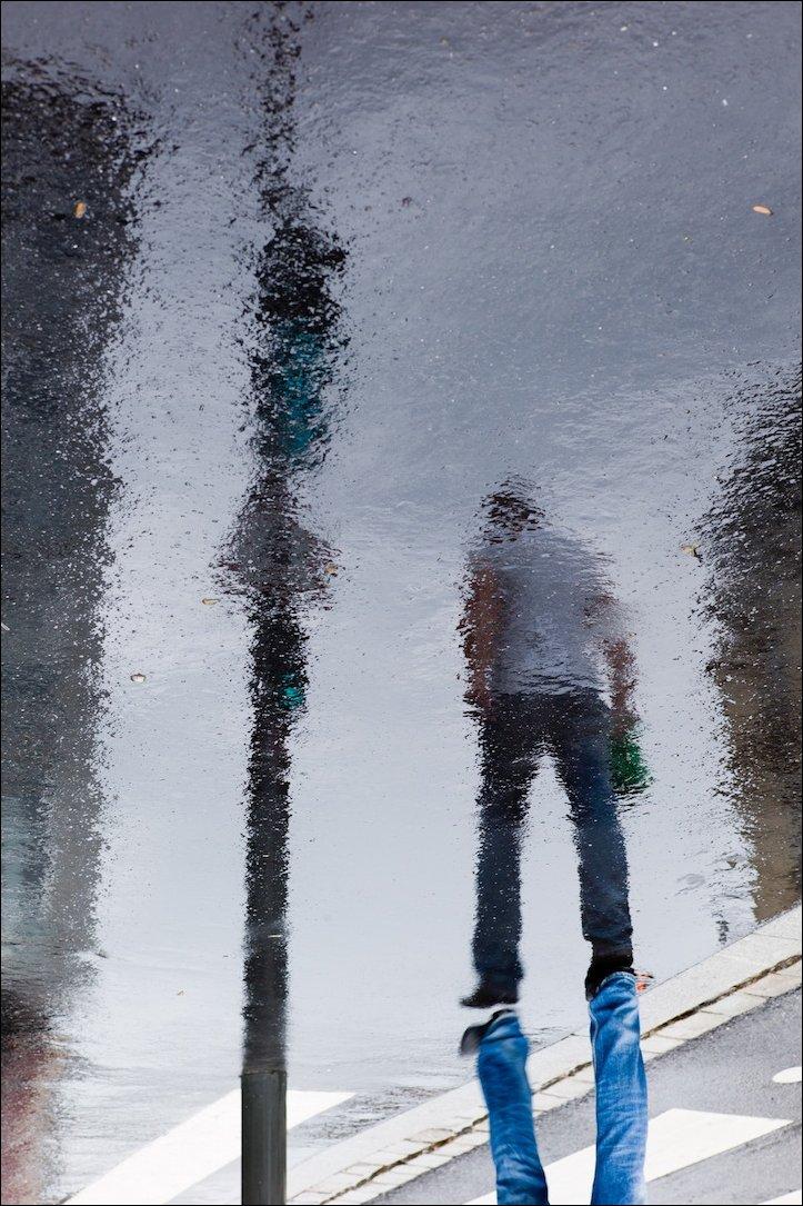 Улицы в отражении мокрого асфальта