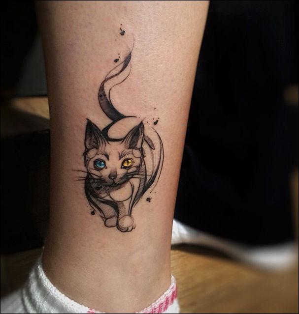 татуировка в виде кошки